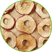 Dried apples on baking paper