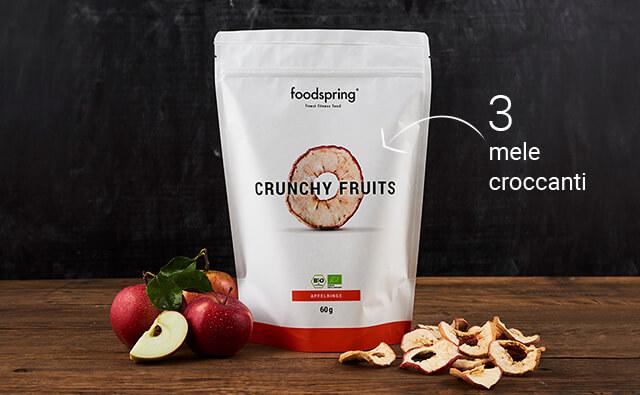 Confezione di anelli di mela Crunchy foodspring con 2 mele davanti