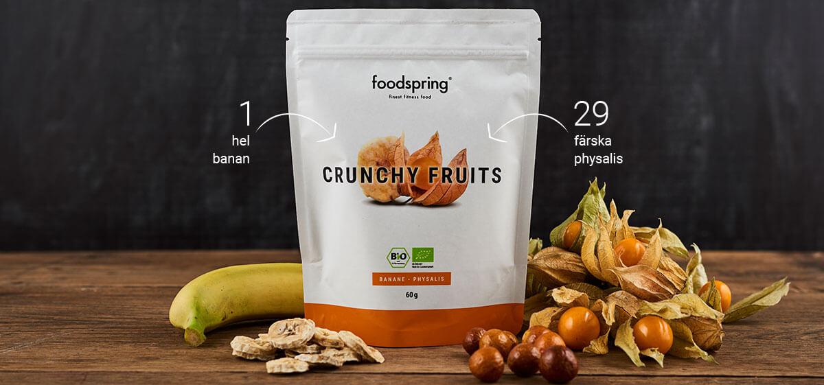 Förpackning Crunchy Fruits med färska bananer och physalis i förgrunden