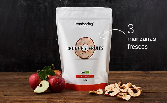 Envase de aros crujientes de manzana foodspring con 2 manzanas delante